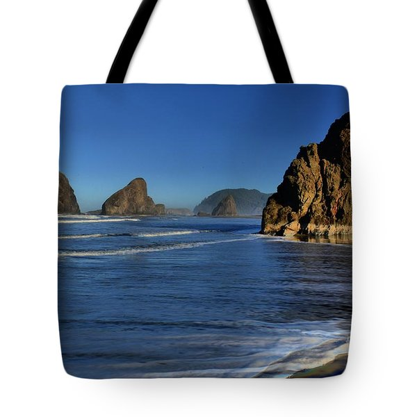 Bandon Sea Stacks In The Surf Tote Bag by Adam Jewell
