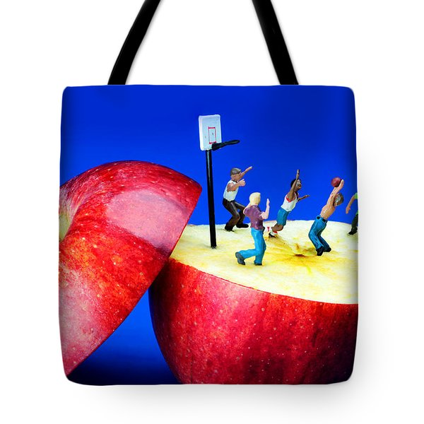 Basketball Games On The Apple Little People On Food Tote Bag by Paul Ge