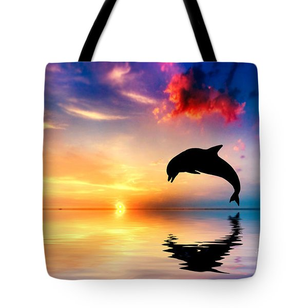 Beautiful Ocean And Sunset With Dolphin Jumping Tote Bag by Michal Bednarek