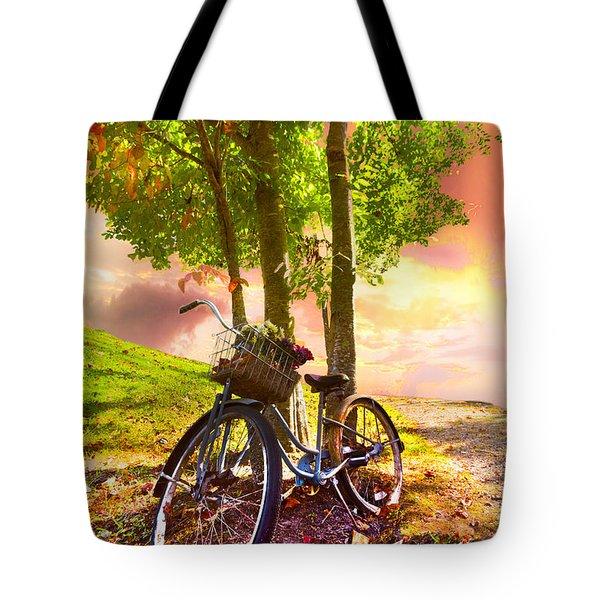 Bicycle Under The Tree Tote Bag by Debra and Dave Vanderlaan