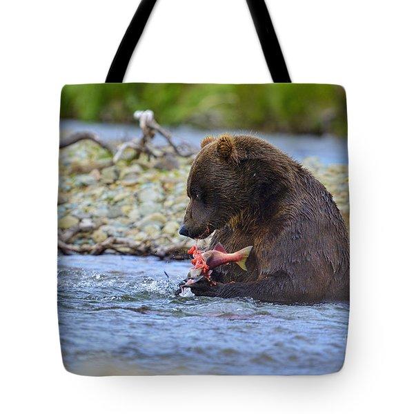 Big Brown Bear Eating Salmon In Stream Tote Bag by Dan Friend