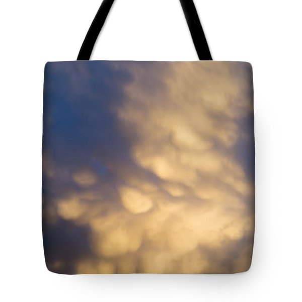 bizarre clouds Tote Bag by Michal Boubin