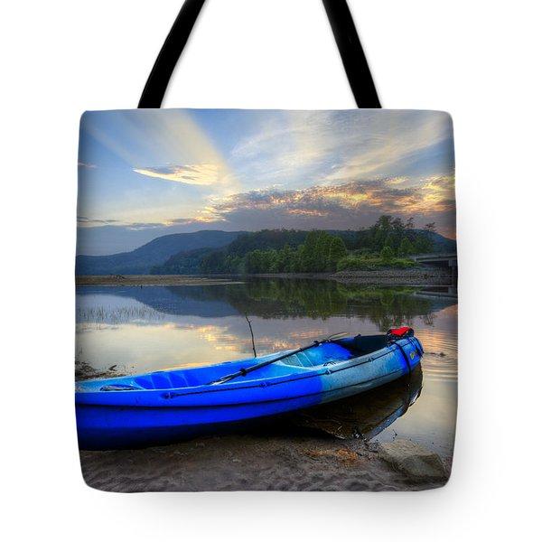 Blue Canoe At Sunset Tote Bag by Debra and Dave Vanderlaan