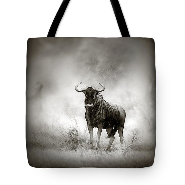 Blue Wildebeest In Rainstorm Tote Bag by Johan Swanepoel