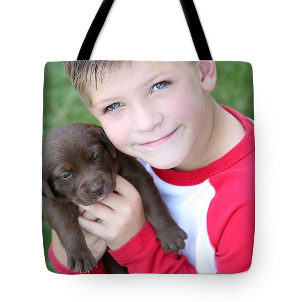 Boy Holding Puppy Tote Bag by Colleen Cahill