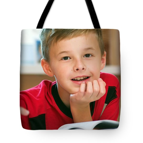 Boy Reading Book Portrait Tote Bag by Michal Bednarek