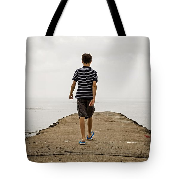 Boy Walking On Concrete Beach Pier Tote Bag by Edward Fielding