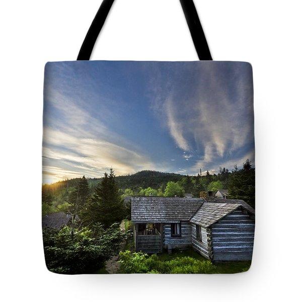 Cabins at Dawn Tote Bag by Debra and Dave Vanderlaan