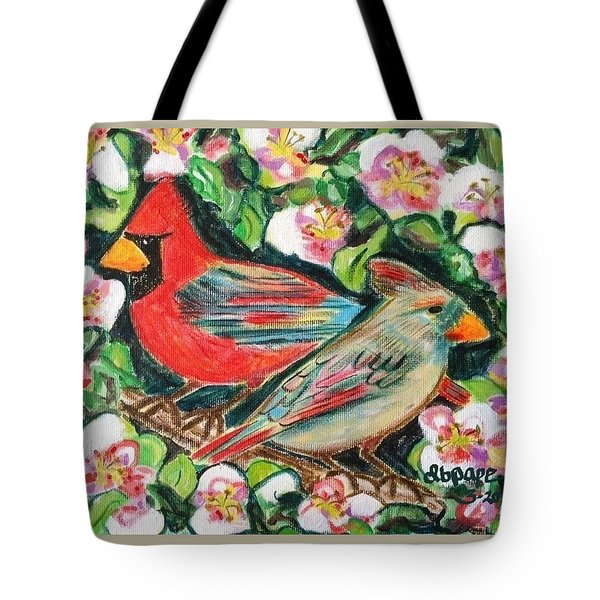 Cardinals In An Apple Tree Tote Bag by Diane Pape