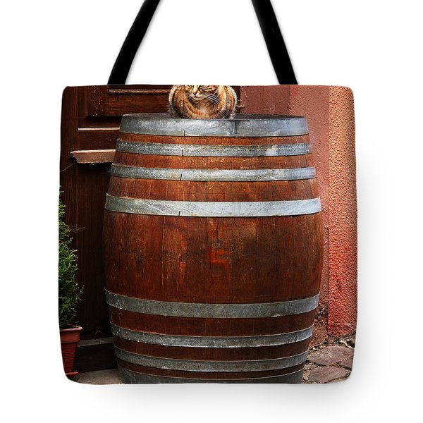 Cat Guarding a Wine Barrel in Alsace Tote Bag by Greg Matchick