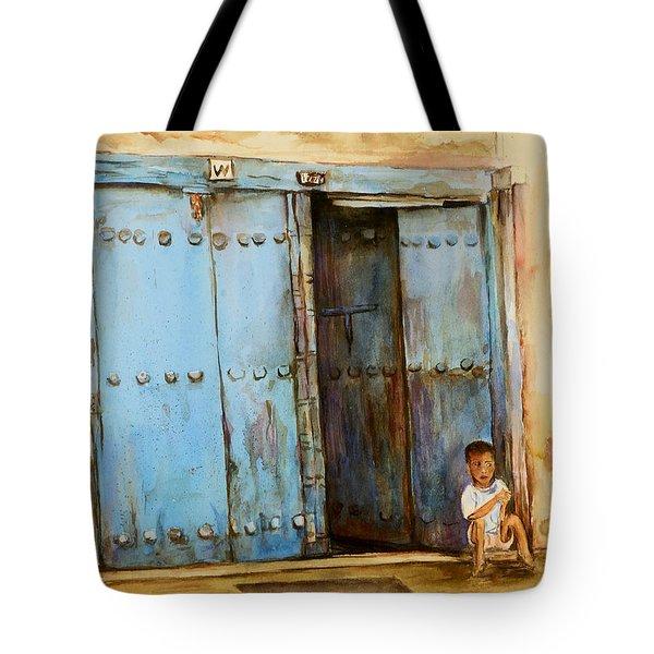 Child Sitting In Old Zanzibar Doorway Tote Bag by Sher Nasser