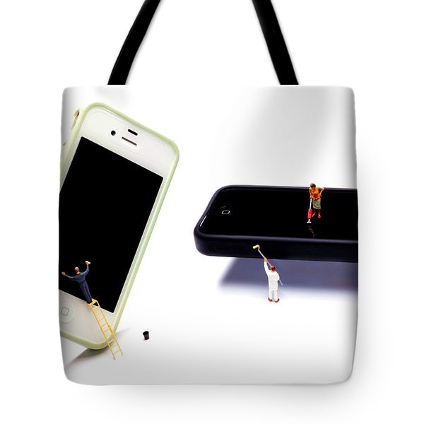 Cleaning The Iphones Little People Big Worlds Tote Bag by Paul Ge