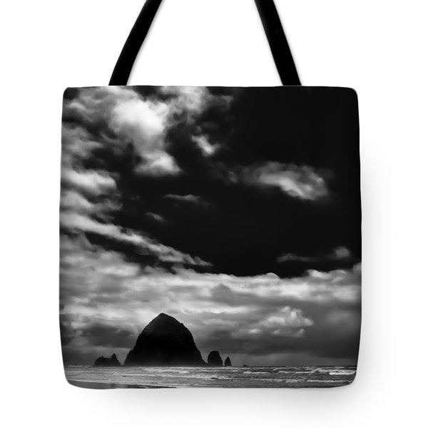 Clouds over Haystack Rock on Cannon Beach Tote Bag by David Patterson
