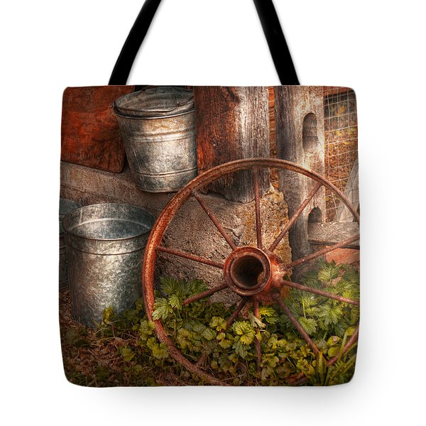 Country - Some dented pails and an old wheel  Tote Bag by Mike Savad