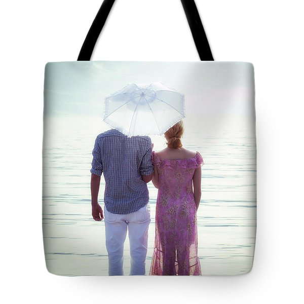 couple on the beach Tote Bag by Joana Kruse