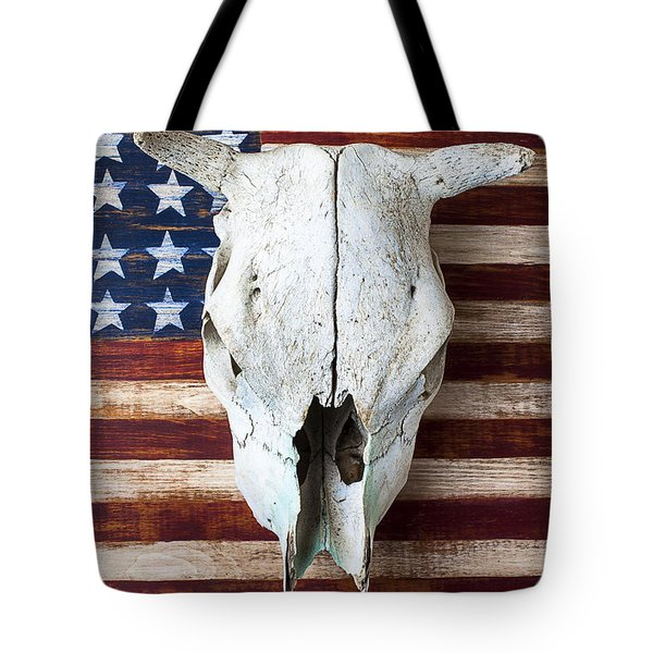 Cow skull on folk art American flag Tote Bag by Garry Gay