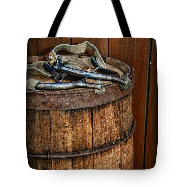 Cowboy Spurs on Wooden Barrel Tote Bag by Paul Ward
