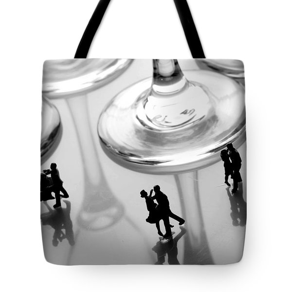 Dancing among glass cups Tote Bag by Paul Ge