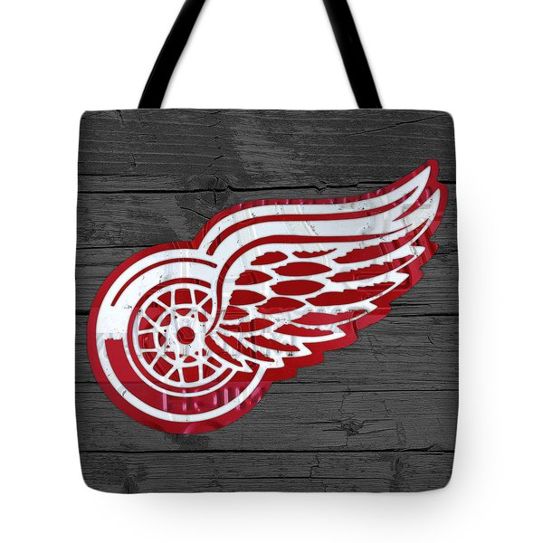 Detroit Red Wings Recycled Vintage Michigan License Plate Fan Art On Distressed Wood Tote Bag by Design Turnpike
