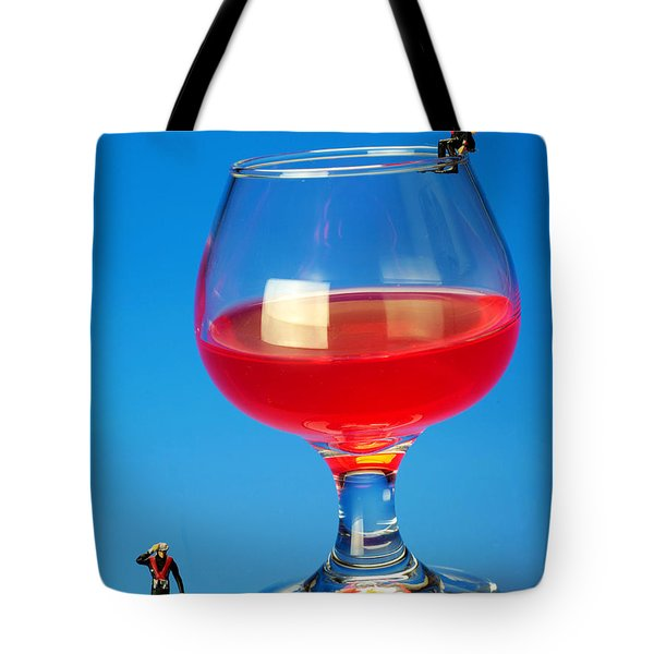 Diving In Red Wine Little People Big Worlds Tote Bag by Paul Ge