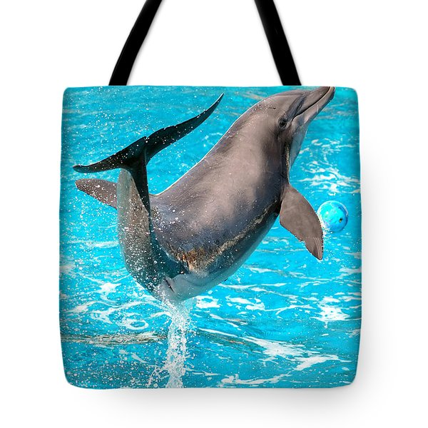 Dolphin Plays Tote Bag by Michal Bednarek