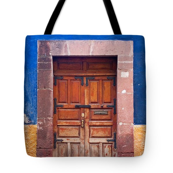 Door In Blue And Yellow Wall Tote Bag by Oscar Gutierrez