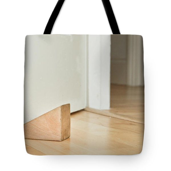 Door stopper Tote Bag by Tom Gowanlock