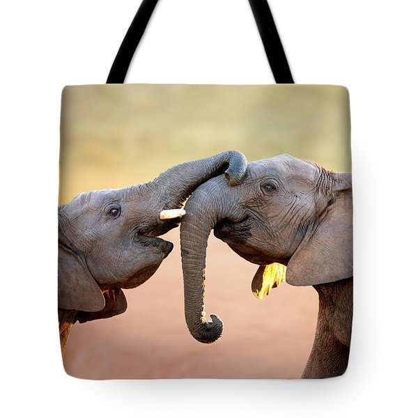 Elephants Touching Each Other Tote Bag by Johan Swanepoel