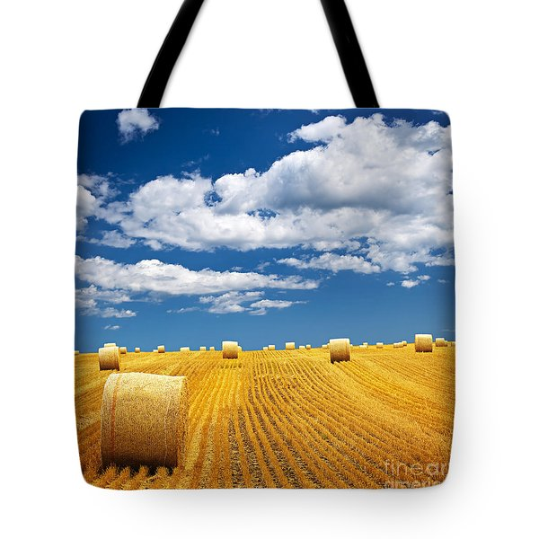 Farm field with hay bales Tote Bag by Elena Elisseeva