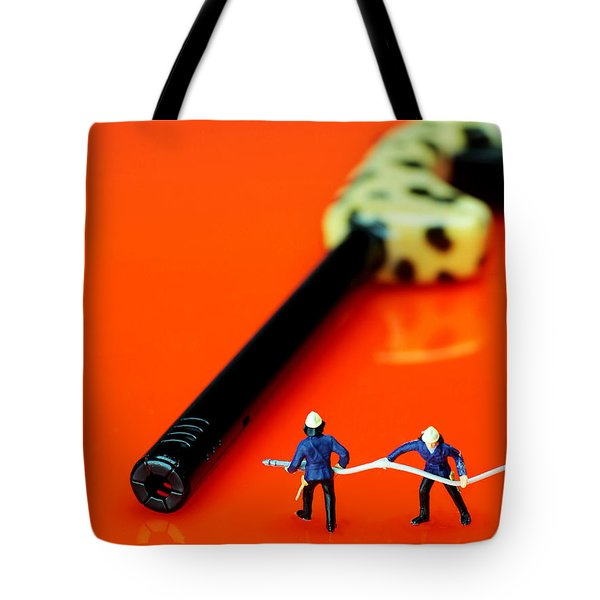 Fire fighters and fire gun little people big worlds Tote Bag by Paul Ge