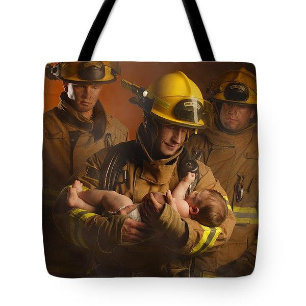 Fire Fighters Rescuing A Baby Tote Bag by Don Hammond