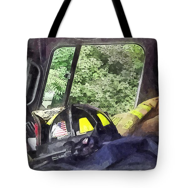 Firemen - Helmet Inside Cab Of Fire Truck Tote Bag by Susan Savad