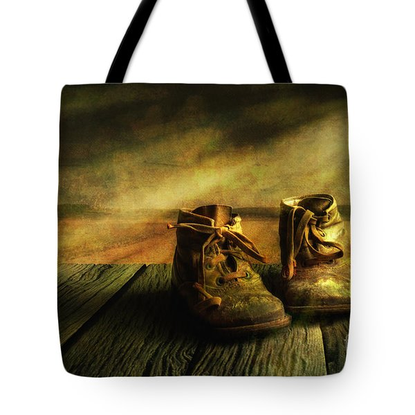 First shoes Tote Bag by Veikko Suikkanen