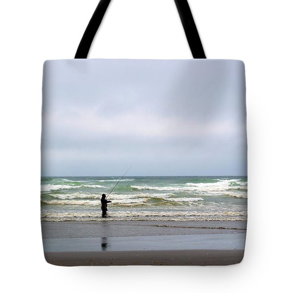 Fisherman Bracing The Weather Tote Bag by Roger Reeves  and Terrie Heslop