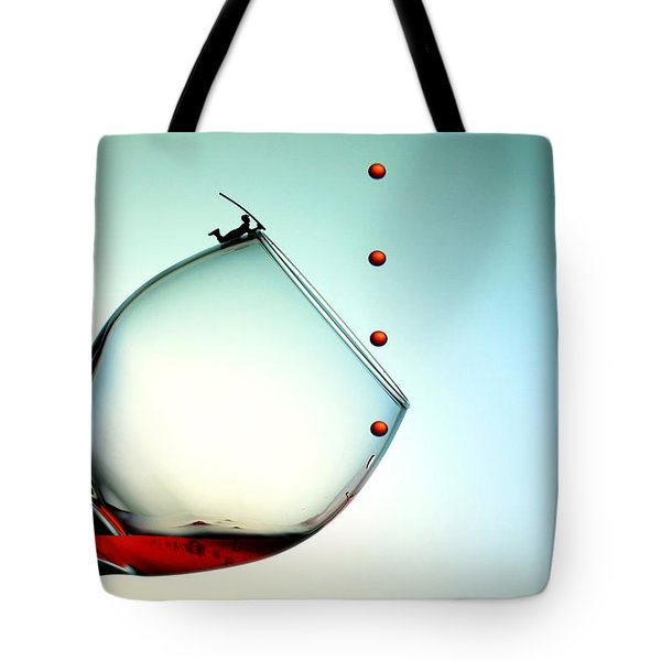 Fishing On A Glass Cup With Red Wine Droplets Little People On Food Tote Bag by Paul Ge