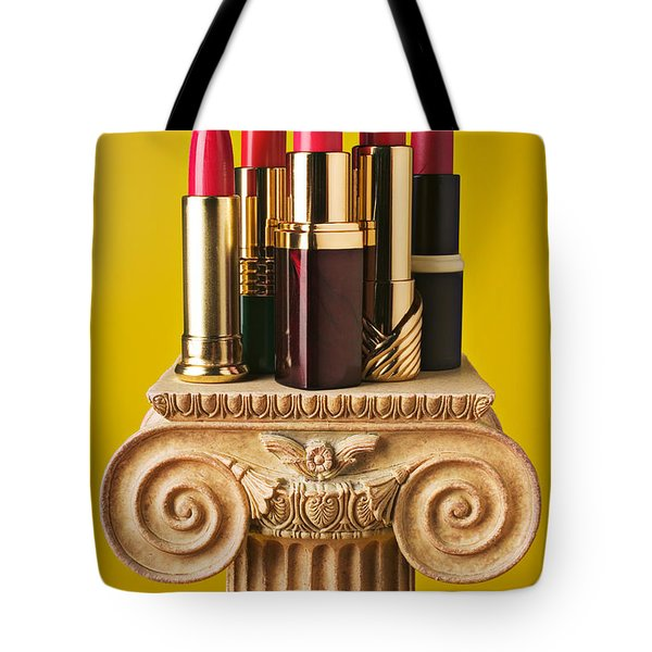 Five Red Lipstick Tubes On Pedestal Tote Bag by Garry Gay