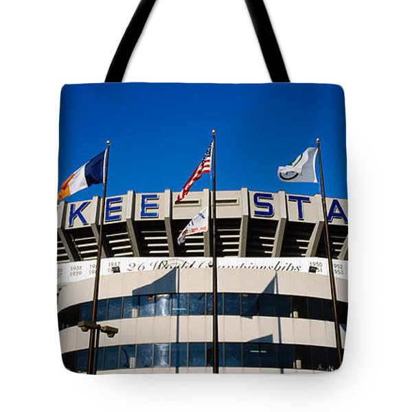 Flags In Front Of A Stadium, Yankee Tote Bag by Panoramic Images