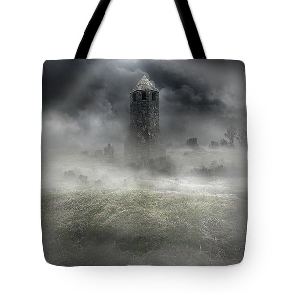 Foggy Landscape With Dark Tower Tote Bag by Jaroslaw Blaminsky