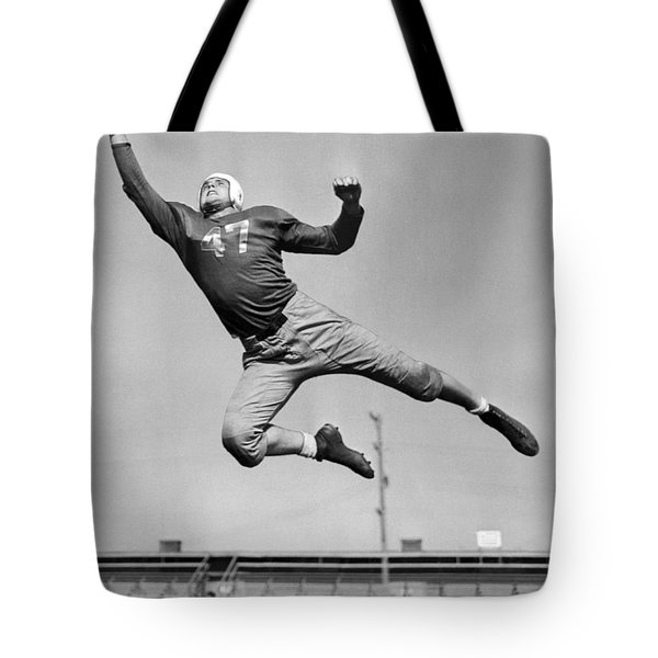 Football Player Catching Pass Tote Bag by Underwood Archives