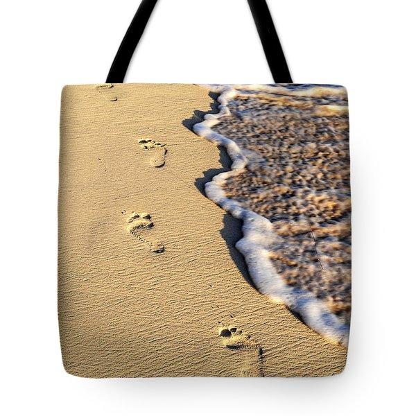 Footprints on beach Tote Bag by Elena Elisseeva