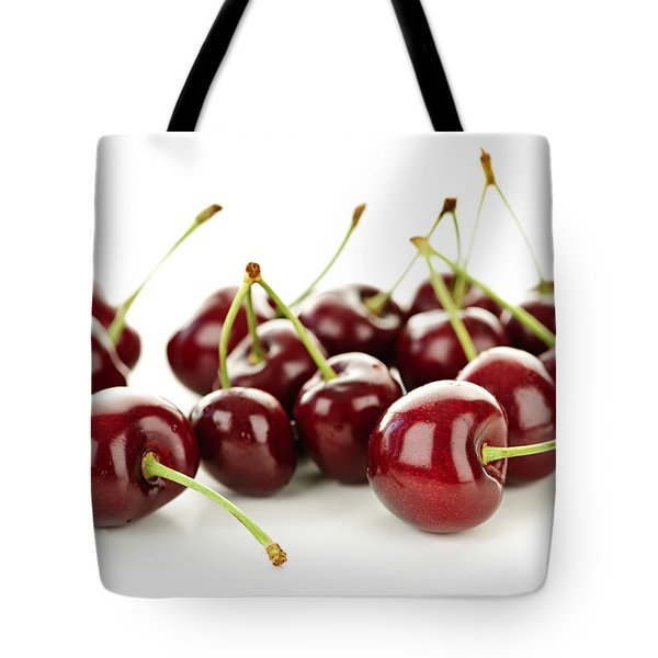 Fresh cherries on white Tote Bag by Elena Elisseeva