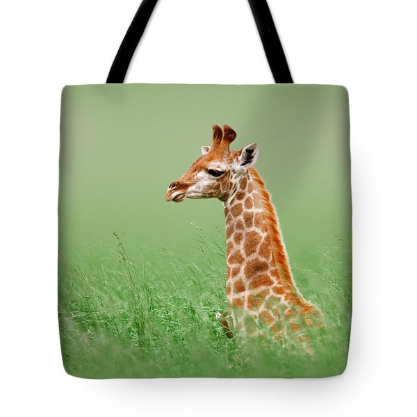 Giraffe Lying In Grass Tote Bag by Johan Swanepoel