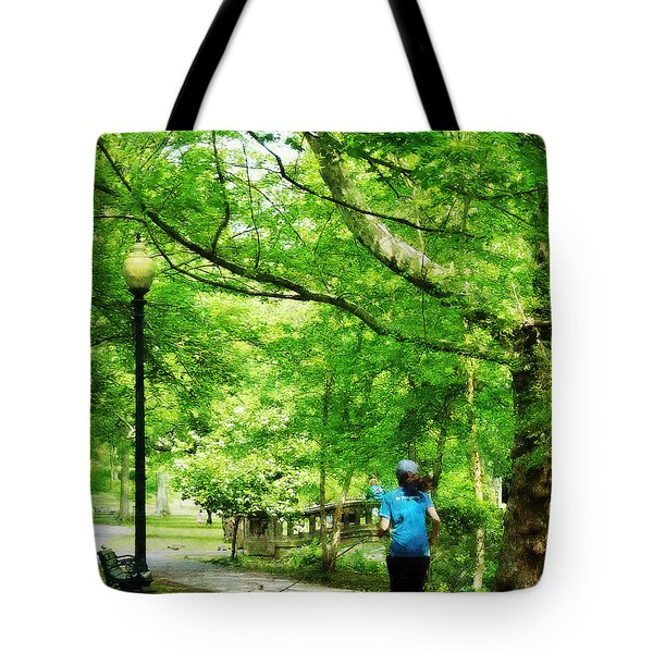 Girl Jogging With Dog Tote Bag by Susan Savad