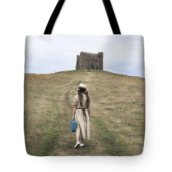girl walks to a chapel Tote Bag by Joana Kruse