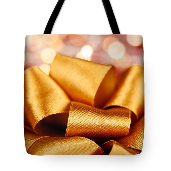 Gold gift bow with festive lights Tote Bag by Elena Elisseeva