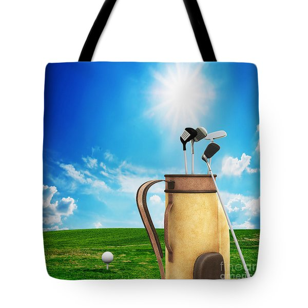 Golf Equipment And Ball On Golf Course Tote Bag by Michal Bednarek