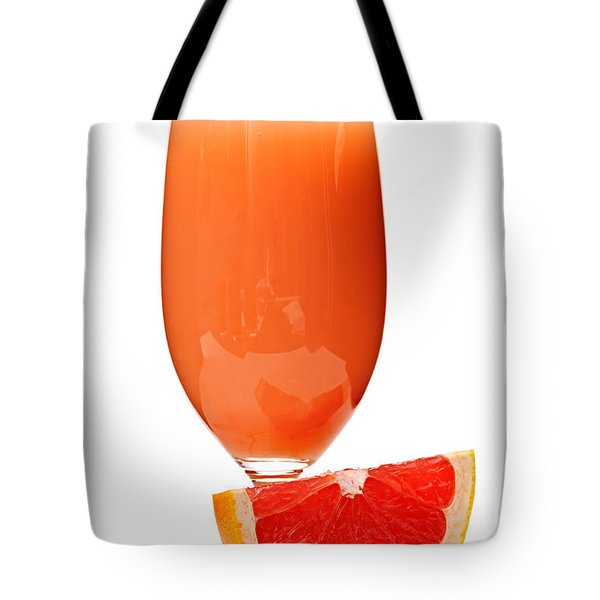 Grapefruit juice in glass Tote Bag by Elena Elisseeva