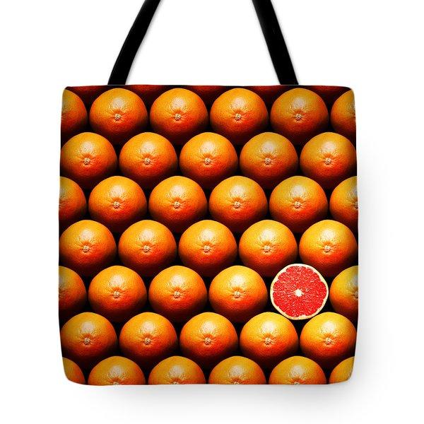 Grapefruit slice between group Tote Bag by Johan Swanepoel