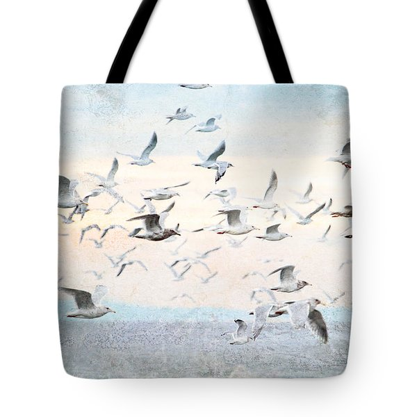 Gulls Flying Over The Ocean Tote Bag by Peggy Collins