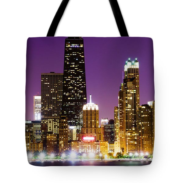 Hancock Building At Night In Chicago Tote Bag by Paul Velgos